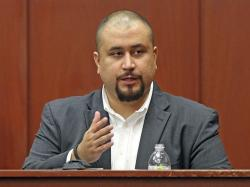 In this Sept. 13, 2016, file photo, George Zimmerman looks at the jury as he testifies in a Seminole County courtroom in Orlando, Fla.
