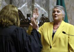 In this Jan. 9, 2017 file photo, Sen. Maureen Walsh, R-Walla Walla, right, takes the oath of office on the opening day of the 2017 legislative session at the Capitol in Olympia, Wash.