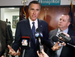 In this Friday Jan., 18, 2019 file photo, Utah Sen. Mitt Romney, left, speaks with reporters after visiting with local officials to discuss how the four-week partial government shutdown is impacting an area with several major federal employers, including the Internal Revenue Service in Ogden, Utah