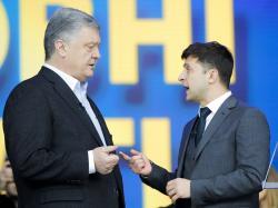 Ukrainian President Petro Poroshenko, left, and Ukrainian presidential candidate and popular comedian Volodymyr Zelenskiy, right, argue their debates at the Olympic stadium in Kiev, Ukraine, Friday, April 19, 2019