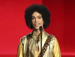 Prince presents the award for favorite album - Soul/R&B at the American Music Awards in Los Angeles.