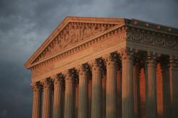 The U.S. Supreme Court is seen at sunset in Washington.