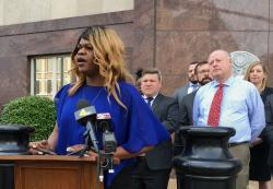 Lead plaintiff Kayla Gore speaks at a news conference outside the federal courthouse in Nashville, Tenn.