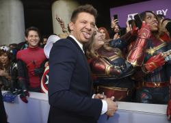 """Jeremy Renner takes a selfie with a fan as he arrives at the premiere of """"Avengers: Endgame"""" at the Los Angeles Convention Center."""