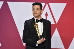"Rami Malek, winner of the award for best performance by an actor in a leading role for ""Bohemian Rhapsody"", poses in the press room at the Oscars."