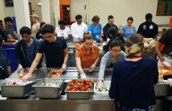 Volunteers put together food trays at Three Square, a food bank in Las Vegas.
