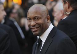 Director John Singleton arrives at the 80th Academy Awards in Los Angeles.