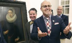 "A Los Angeles couple, Craig Gilmore, right, and David Crocker, pose in front of a 17th painting, ""Portrait of a Lady"" by the Flemish artist Melchior Geldorp at the National Museum in Warsaw, Poland."