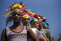 In this May 14, 2016 file photo, members of Cuba's LGBT community take part in a gay pride parade in Havana, Cuba.