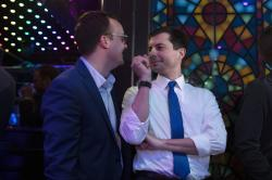 Democratic presidential candidate Pete Buttigieg, right, shares a light moment with husband, Chasten Glezman, while waiting to be introduced at a campaign event Thursday, May 9, 2019, in West Hollywood, Calif.
