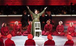 "Caroline Worra and members of the ensemble in ""The Handmaid's Tale."""