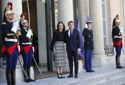 New Zealand Prime Minister Jacinda Ardern, center left, is greeted by French President Emmanuel Macron, center right, as she arrives at the Elysee Palace, in Paris, Wednesday, May 15, 2019