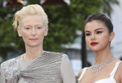 Tilda Swinton, left, and Selena Gomez pose for photographers upon arrival at the opening ceremony and the premiere of the film 'The Dead Don't Die' at the 72nd international film festival, Cannes.