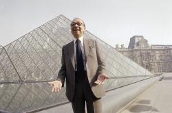 In this March 29, 1989, file photo, Chinese-American architect I.M. Pei laughs while posing for a portrait in front of the Louvre glass pyramid