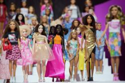 In this Feb. 20, 2018, file photo dozens of Barbie dolls are displayed at the Mattel showroom at Toy Fair in New York.