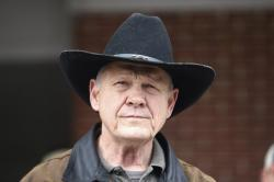 In this Dec. 12, 2017, file photo, Roy Moore speaks to the media after he rode in on a horse to vote in Gallant, Ala.