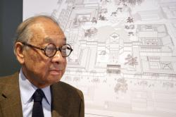 In this Nov. 3, 2003, photo, Chinese-American architect I.M. Pei stands with the plans of the Suzhou Museum in Suzhou in eastern China's Jiangsu Province.