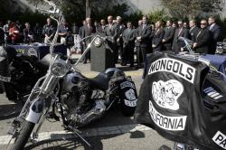 In this Oct. 21, 2008, file photo, the Mongols motorcycle club's logo adorns clothing and motorcycles at a news conference in Los Angeles.
