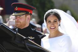 In this Saturday, May 19, 2018 file photo, Britain's Prince Harry and his wife Meghan Markle leave after their wedding ceremony, at St. George's Chapel in Windsor Castle in Windsor, near London, England. Sunday, May 19, 2019.