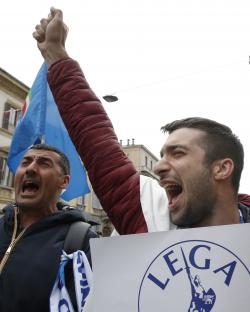People attend a rally organized by League leader Matteo Salvini, with leaders of other European nationalist parties, ahead of the May 23-26 European Parliamentary elections, in Milan, Italy, Saturday, May 18, 2019. (AP Photo/Antonio Calanni)