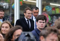 France's President Emmanuel Macron, centre, walks during a visit to Biarritz, southwestern France, Friday, May 17, 2019. (AP Photo/Bob Edme)