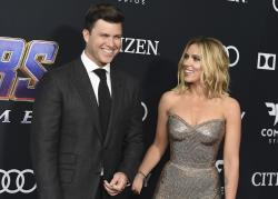 "Colin Jost, left, and Scarlett Johansson arrive at the premiere of ""Avengers: Endgame"" at the Los Angeles Convention Center."