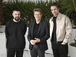 Director Robert Eggers, from left, actors Willem Dafoe and Robert Pattinson pose for portrait photographs for the film 'The Lighthouse' at the 72nd international film festival, Cannes.