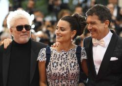 Director Pedro Almodovar, from left, actors Penelope Cruz and Antonio Banderas pose for photographers upon arrival at the premiere for the film 'Pain and Glory' at the 72nd international film festival, Cannes.