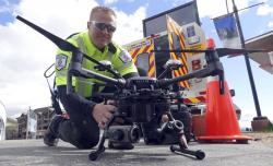 Travis White, Utah Department of Transportation, Highway Incident Management Team, holds their drone at a drone demo Monday, May 20, 2019, in Park City, Utah