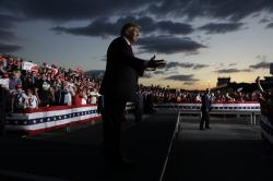 President Donald Trump gestures to the crowd as he finishes speaking at a campaign rally, Monday, May 20, 2019, in Montoursville, Pa.