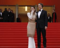 Actors August Diehl, right, and Valerie Pachner pose for photographers upon arrival at the premiere of the film 'A Hidden Life' at the 72nd international film festival, Cannes.