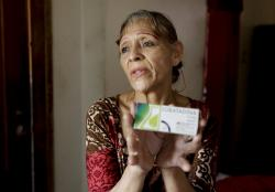 In this April 11, 2019 photo, Bertha Dun shows medicine bought with cryptocurrency through online transfers, in Barquisimeto, Venezuela, Thursday, April 11, 2019