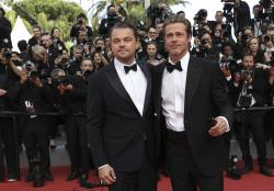Actors Leonardo DiCaprio, left, and Brad Pitt pose for photographers upon arrival at the premiere of the film 'Once Upon a Time in Hollywood' at the 72nd international film festival, Cannes.