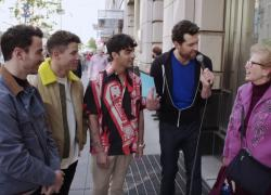"From left to right: Kevin Jonas, Nick Jonas, Joe Jonas and Billy Eichner talk to a New Yorker on ""Billy on the Street."""