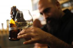 Craft brewer from Biratenu, the Jerusalem Beer Center, Shmuel Naky, right, pours beer during a press conference in Jerusalem, Wednesday, May 22, 2019