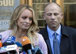 Adult film actress Stormy Daniels, left, stands with her lawyer Michael Avenatti.