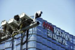 In this Wednesday, May 22, 2019, photo, surveillance cameras are seen outside the headquarters of Chinese security technology company Hikvision in Hangzhou in eastern China's Zhejiang province