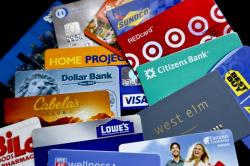 In this Jan. 31, 2018, file photo, an assortment of credit cards and rewards cards are shown in Zelienople, Pa.