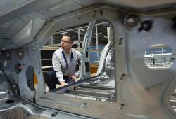 In this Tuesday, May 14, 2019 photo, Heiko Roesch, head of body construction, explains details of the new electric 'ID.3' car body during a press tour at the plant of the German manufacturer Volkswagen AG (VW) in Zwickau, Germany