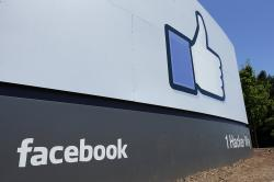 This July 16, 2013 file photo shows a sign at Facebook headquarters in Menlo Park, Calif. Facebook said Thursday, May 16, 2019, that it has banned Archimedes, an Israeli company that ran an influence campaign aimed at disrupting elections in various countries, and has canceled dozens of accounts engaged in spreading disinformation