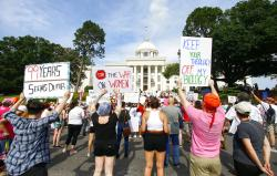 Protesters for women's rights hold a rally on the Alabama Capitol steps.