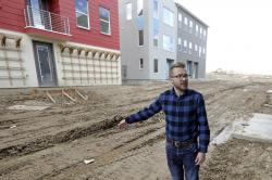 In this April 13, 2019, photo, Parry Harrison, 26, speaks during an interview outside his townhouse in the Daybreak development, in South Jordan, Utah.