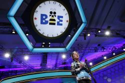 In this May 31, 2018 file photo, Lauren Guo, 12, from Arvada, Colo., competes in the Scripps National Spelling Bee in Oxon Hill, Md.