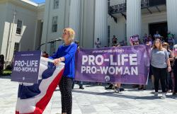 In this May 22, 2019, photo, Beck Gerritson, president of Eagle Forum of Alabama, speaks at an anti-abortion rally outside the Capitol in Montgomery, Ala