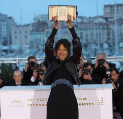 Director Mati Diop, winner of the grand prix Palme d'Or award for the film 'Atlantique' poses for photographers during a photo call following the awards ceremony