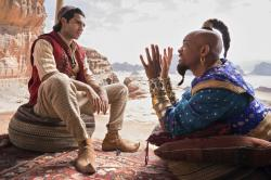"Mena Massoud as Aladdin, left, and Will Smith as Genie in Disney's live-action adaptation of the 1992 animated classic ""Aladdin."""