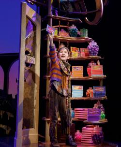 "Henry Boshart as Charlie Bucket in ""Willy Wonka and the Chocolate Factory."" Photo by Joan Marcus."