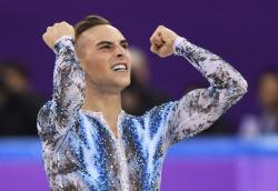 Olympian figure skater Adam Rippon celebrates after a performance