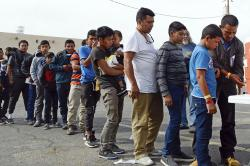 Migrants at the Gospel Rescue Mission in Las Cruces, N.M., on April 12 | Photo: Associated Press