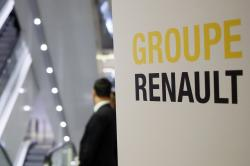 A sign of French automaker Renault Group shows the way for the Renault shareholders general meeting in Paris, France, Wednesday, June 12, 2019